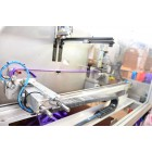 Robots ar kuru mēs šujam augstas kvalitātes kravas stiprināšanas siksnas un stropes